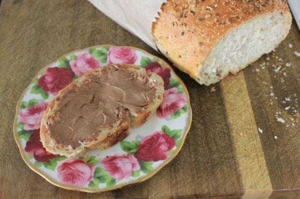 Chocolate cream cheese spread on organic five-grain sourdough