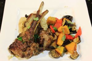 Moroccan-spiced lam cutlets with homemade hummus and seasonal vegetables