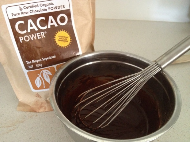 Combine melted raw cacao butter and raw cacao powder