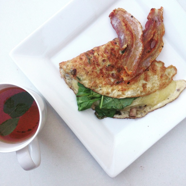Spinach, mushroom and cheese omelette with bacon